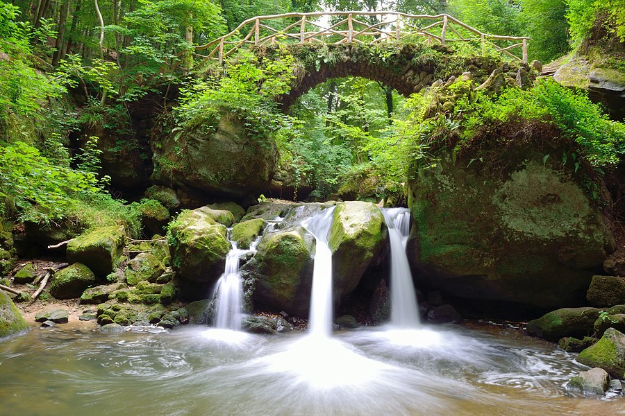 The Schéissendëmpel waterfall in the valley of the Ernz noire in the Mullerthal region in Luxembourg.