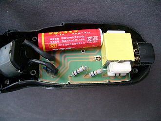 Electric razor - The standard AA-size Ni-Cd battery (600 mAh) is soldered in place, deterring user replacement.