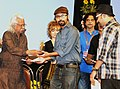 Shri Adoor Gopalakrishnan presented the Best Short Fiction film award to Kashmiri film Tamaash in National Competition, received by Directors Shri Satyanshu and Shri Devanshu, at the MIFF, 2014, in Mumbai.jpg