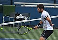 Simone Bolelli proving he can hit volleys with one hand tied behind his back (31958634077).jpg