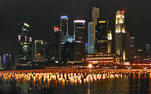 The skyline of Singapore at night; Many buildings can be seen illuminated for aesthetic reasons.