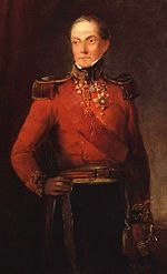 Painting of a standing man with his right hand on his hip. He wears a red military coat and dark blue trousers.