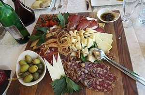 Slovenian cuisine - Plate of various sorts of Slovenian cheese and meat together with garnish