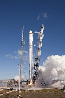 SpaceX Falcon 9 with Dragon COTS Demo 1 during static fire test.jpg