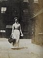 St Bartholomew's Hospital, London; a smiling nurse carrying Wellcome V0028943.jpg
