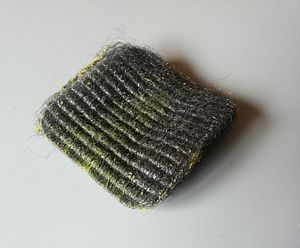 Steel wool - Soap-impregnated steel wool pad for household cleaning