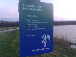 Staatsbosbeheer - The logo of Staatsbosbeheer on an entrance sign of one of its nature reserves