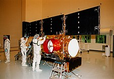 The solar arrays being checked in the Payload Hazardous Servicing Facility