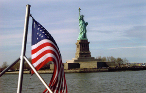 A photo of the Statue of Liberty behind an Ame...