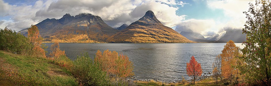 A view to the autumnal mountains such as Horsnesfjellet and Hatten on the other side of Storfjorden, Troms, Norway in 2010 September.