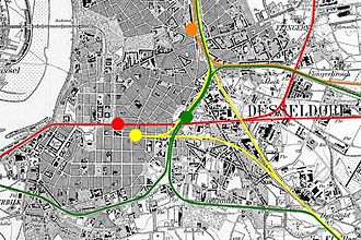 Düsseldorf Hauptbahnhof - Realigment of the lines, former BME line in red, former CME lines in yellow, former RhE line in orange, new combined lines in green