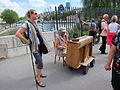 Street performer with an unusual instrument, Paris.jpg