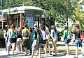 Students getting on Streetcar in front of Gibson (2901567167).jpg