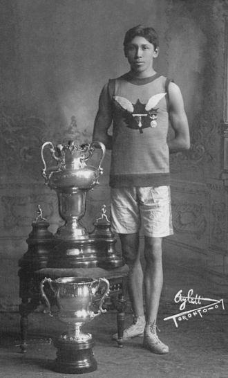 Tom Longboat - Tom Longboat with the Ward Marathon Trophy