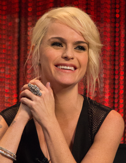 "Manning was described by critic Horatia Harrod as ""brilliantly unhinged"" in her portrayal of Doggett. Taryn Manning at Paley Fest Orange Is The New Black crop.png"