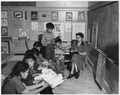 Teacher and students in day school classroom - NARA - 295151.tif