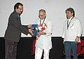 The Director, IFFI, Shri Shankar Mohan felicitating the veteran film lyricist, director, screen writer, producer and poet, Shri Gulzar at the inauguration of 'Retrospective of Gulzar'.jpg