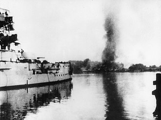 Battle of Westerplatte - German battleship Schleswig-Holstein firing at the Polish Military Transit Depot during the siege of Westerplatte.