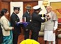 The Officers of the Kendriya Sainik Board pinning a flag on the Prime Minister, Shri Narendra Modi, on the occasion of Armed Forces Flag Day, in New Delhi on December 07, 2015.jpg