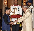 The President, Shri Pranab Mukherjee presenting the Padma Shri Award to Shri Kailash Kher, at the Civil Investiture Ceremony, at Rashtrapati Bhavan, in New Delhi on April 13, 2017.jpg