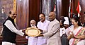 The President, Shri Ram Nath Kovind presenting the Outstanding Parliamentarian Award for the year 2016 to Shri Dinesh Trivedi, at a function, at Parliament House, in New Delhi.JPG