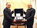 The President of Russian Federation, Mr. Vladimir Putin presents to the Prime Minister, Shri Narendra Modi a page from Mahatma Gandhi's diary containing Gandhiji's handwritten notes, at Moscow, in Russia on December 24, 2015.jpg