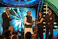 The Prime Minister, Dr. Manmohan Singh giving away the Sports CNN-IBN Indian of the Year 2009 to Saina Nehwal, at a function, in New Delhi on December 21, 2009.jpg