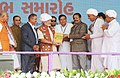 The Prime Minister, Shri Narendra Modi being presented the memento at the inauguration ceremony of the Amul Cheese Plant and Whey Drying Pant, in Palanpur, Banaskantha, Gujarat.jpg