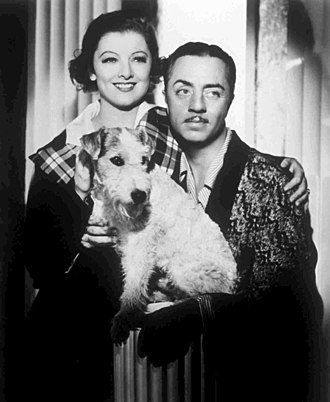William Powell - William Powell and his frequent co-star Myrna Loy as Nick and Nora Charles in a promotional photo for The Thin Man from 1934, with Skippy as Asta.