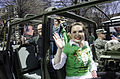 Tina Raziano, center, a liaison with the SHARE Military Initiative at Shepherd Center, waves to the crowd while riding in a Humvee during the annual St. Patrick's Day Parade 130316-A-MV865-010.jpg