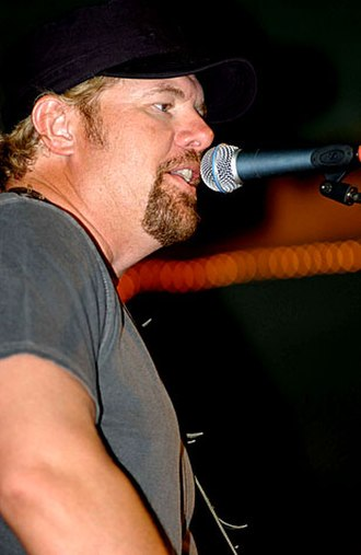 Toby Keith - Keith performs for the troops at the O'Callahan's Cantina at Camp Lemonnier, Djibouti, on May 31, 2006.