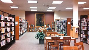 Tompkins County Public Library - One of the reading areas of the library, with a painting of Ezra Cornell in the background
