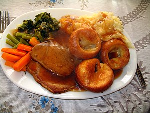 National dish - A Sunday roast—in this example, consisting of roast beef, mashed potatoes, vegetables and mini Yorkshire puddings—is a national dish of England.