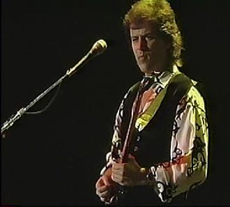 Yes (band) - Trevor Rabin, pictured here at a Yes concert in 1994. Rabin joined the band when it reformed in 1982, and stayed until 1994, when he decided to become a film composer.