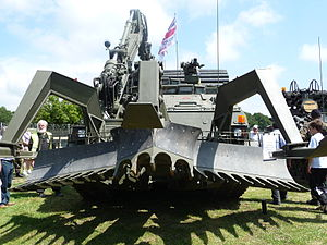 Mine plow - Trojan AVRE of the Royal Engineers with full-width mine plow and fascine.