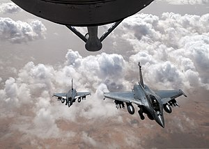 Two French Air Force Rafale fighter aircraft, below, prepare to break formation after refueling with a U.S. Air Force KC-135 Stratotanker aircraft with the 351st Expeditionary Air Refueling Squadron over Mali 130423-F-DT859-086.jpg