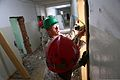 U.S. Marine Corps Lance Cpl. John Toniolo, a combat engineer with Alpha Company, 9th Engineer Support Battalion, 3rd Marine Logistics Group, measures the width of a door frame at a school during Khaan Quest 2013 130724-M-MG222-001.jpg