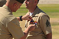 U.S. Marine Corps Sgt. Terry Southworth, right, receives a Purple Heart in Twentynine Palms, Calif., May 23, 2013, for injuries sustained during his last deployment to Afghanistan 130523-M-KI464-634.jpg