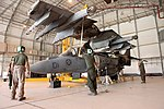 U.S. Marines with Marine Attack Squadron (VMA) 211 replace the wings of an AV-8B Harrier II aircraft at Camp Bastion in Helmand province, Afghanistan, Sept 120903-M-EF955-072.jpg