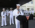 U.S. Navy Aviation Structural Mechanic 1st Class Ry Vansickle, at lectern, selected for promotion to chief petty officer, addresses the audience during a 9-11 remembrance ceremony at Naval Air Facility Misawa 120911-N-ZI955-034.jpg