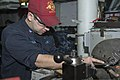 U.S. Navy Machinery Repairman 2nd Class Arthur Lujan uses a lathe to make a bolt in the general workshop aboard the guided missile destroyer USS Stout (DDG 55) while in port at Naval Support Activity Souda Bay 131212-N-UD469-162.jpg