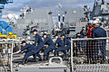 U.S. Sailors aboard the guided missile destroyer USS Hopper (DDG 70) moor the ship upon its return to Joint Base Pearl Harbor-Hickam, Hawaii, July 22, 2013, after completing an independent deployer certification 130722-N-WF272-111.jpg