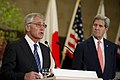 U.S. Secretary of Defense Chuck Hagel, left, and U.S. Secretary of State John Kerry, right, along with Japanese Minister of Foreign Affairs Fumio Kishida and Japanese Minister of Defense Itsunori Onodera, hold 131003-D-BW835-965.jpg