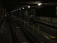 U2 tunnel rail with yellow posts.jpg