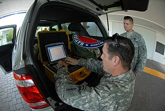Hurricane Ike - A Florida Army National Guardsman uses a Single Mobile User Case Set to send a situation report on ongoing preparations for Hurricane Ike in Key West, Florida.
