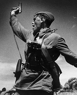 A Soviet junior political officer (Politruk) urges Soviet troops forward against German positions (12 July 1942). USSROfficerTT33.JPG