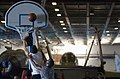 US Navy 021003-N-4309A-008 Crewmembers enjoy a day of playing basketball in the hangar bay during a.jpg