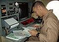 US Navy 021218-N-3658D-002 Lt.j.g. Trevor Arneson conducts preflight checks on a U.S. Navy P-3C Orion.jpg