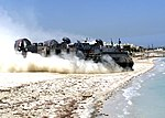 US Navy 030506-N-9109V-004 Landing Craft Air Cushion Eighty Four (LCAC-84) departs the beach with supplies, ammunition, and vehicles.jpg