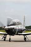 US Navy 030807-N-0000X-002 The T-6 Texan training aircraft prepares to take off from the flight line at Naval Air Station (NAS) Pensacola